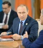 Prezydent Putin tłumaczy się w Astanie z własnej polityki gospodarczej .