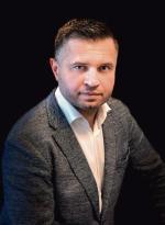 """Piotr Bujak, główny ekonomista PKO BP, ekonomista roku 2020 według """"Parkietu""""."""