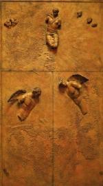 *Wrota  autorstwa Igora  Mitoraja zostaną podzielone na trzy części. Górna z Matką  Boską  będzie nieruchoma, otwierać się natomiast mają ponaddwumetrowe skrzydła z aniołami